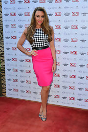 Michelle Heaton chose bold and bright colors on the red carpet when she wore this fitted sheath dress that featured a black and white bodice with a hot pink skirt.