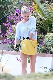 Cameron dug for her keys in this gorgeous yellow leather bag.