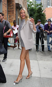 Cameron accentuated her model-worthy stems with short short and nude, peep toe pumps