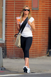 Cameron hit the gym in NYC in style with her tan canvas 'Barbie' bag with black leather detailing.