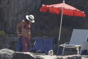 Carla Bruni Shows off Baby Bump in a Bikini While on Vacation