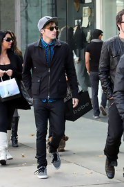 Kendall Schmidt's canvas sneakers kept his look athletic but still stylish.