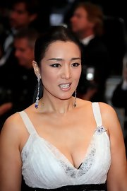 Gong Li's extra long drop diamond and sapphire earrings looked like wearable art.