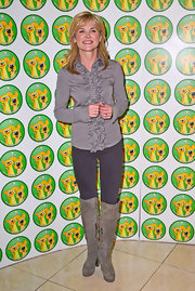 Anthea Turner paired these knee-high suede boots with jeans and a blouse for a casual look at the Wetnose Animal Awards.