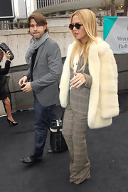 Rachel Zoe upped the wow factor of her plaid suit with an ivory fur coat.