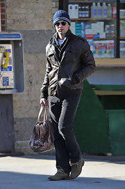 Chace paired his black pants with a brown leather jacket and navy blue knit beanie.