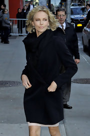 Charlize Theron kept warm outside the 'Late Show with David Letterman' with an extra-long black blazer.