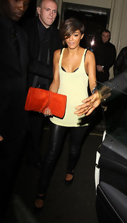 Frankie paired her leather pants with an orange suede clutch.