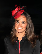 Pippa Middleton wore a decorative hat with red accents.