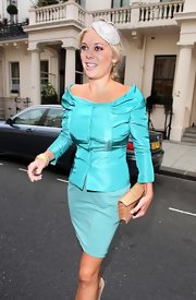 Chelsy was vibrant at the royal wedding in an aqua jacket faille silk jacket with a deep boat neck and a knot detail.