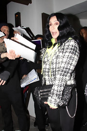 Cher's textured black leather clutch and tweed jacket at the 'Inglourious Basterds' party were a classic pairing.