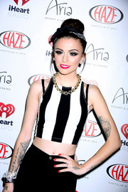 Cher Lloyd flaunted her tiny waist in a boldly striped black-and-white crop-top during the iHeart Radio Festival kickoff party.