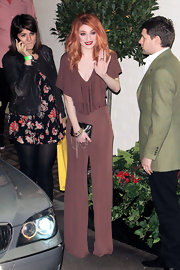 Nicola Roberts carried a petite black leather clutch embellished with dangling chains.