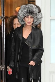 Cher looked fabulous on the streets of Paris in a croc-embossed black leather coat and a fur hat.