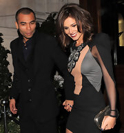 A smiling Cheryl Cole stepped out her her hubby carrying a mirrored metallic gold hard case clutch.