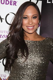 Cheryl Burke wore her long locks in side-swept waves while out at TAO nightclub in Las Vegas.