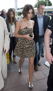 Cheryl paired her printed mini dress with two-toned, peep toe Volnay ankle boots.