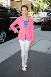 Bailee Madison matched her pink blazer with a pair of white skinny pants.