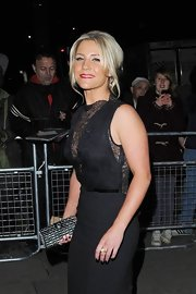 Heidi Range matched her black gown with a glam clutch at the Cosmopolitan Awards.