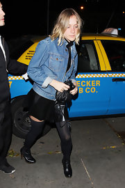 Chloe Sevigny paired her offbeat street attire with studded black leather ankle boots.