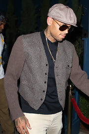 Chris Brown lent a vintage flair to his outfit by wearing a newsboy cap as he exited from Hooray Henry's.