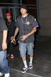 For maximum comfort, Chris Brown opted to wear a pair of faded denim shorts for the Lakers game.