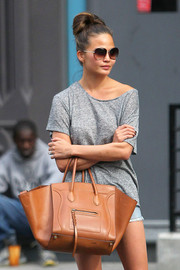 Chrissy Teigen kept it laid-back in a gray T-shirt and cutoffs while out and about in New York City.