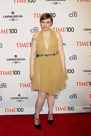 Lena Dunham took the plunge at the Time 100 Gala where she wore this gold frock with a plunging neckline.