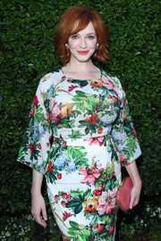 Christina Hendricks looked downright charming in a colorful Dolce & Gabbana floral blouse and a matching skirt at the Rape Foundation benefit.