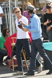 Ryan Gosling wore a pair of cream oxfords with a thick heel as he puzzled over a Rubik's cube on the set of 'Drive.'