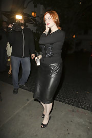 Christina Hendricks opted for an all-black outfit while out and about in LA. She topped it off with black satin peep-toe pumps.
