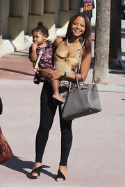 Christina Milian was casual and chic in black skinny jeans, a graphic tank and black heels.