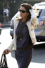 Cindy Crawford accessorized her casual look with long layered necklaces.