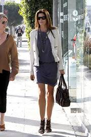 Cindy Crawford added polish to her lavender drop-waist dress with a white cropped collarless jacket.