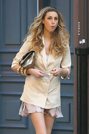 TV star Whitney Port paired her tan blazer with multiple gold bangles.