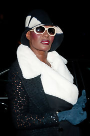Grace Jones stayed warm and stylish at the Sidaction Gala Dinner with these brilliant blue gloves.