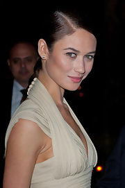 Olga Kurylenko wore her hair with a sleek side part and long braid at the 2012 Sidaction Gala Dinner.