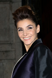 Clotilde Courau wore an edgy-glam pompadour at the Lanvin Spring 2014 show.