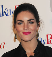 To try Hilary Rhoda's vibrant look, use Chantecaille Hydra Chic Lipstick in Aster. This formulation offers up to six hours of opaque high-impact color. To finish the look, swipe on a clear or pale pink gloss for lots of shine.