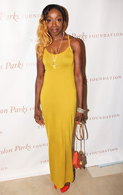 Estelle chose a solid-colored mustard yellow dress for her look at the Gordon Parks Foundation Awards.