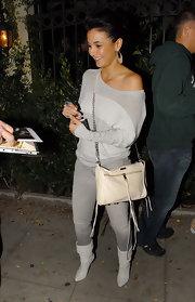 Emmanuelle showed off her cream shoulder cross body bag while hitting Crown Bar in LA.
