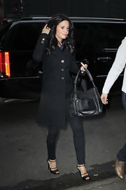 Courteney Cox accented her sleek black streetwear with a matching shoulder bag.