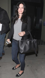 Courteney Cox paired this black blazer over a striped top for a preppy and sophisticated look.
