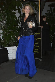 Ali Larter offset the glamorous vibe of her blue gown with a black leather biker jacket.