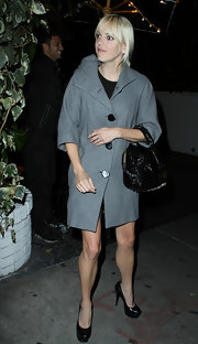 Anna Faris layered a gray '60s inspired swing coat over her LBD out in Hollywood.