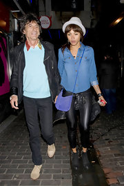 Ana Araujo looked relaxed in a chambray button-down shirt and leather leggings while clubbing with Ronnie Wood.
