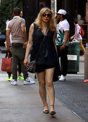 Courtney Love chose this navy flowing top with tassel ties for her look while out in NYC.