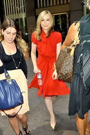 Piper's gold pumps added a striking shimmer to her already striking red dress.