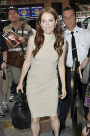 Julianne Moore opted for a beige shift dress at 'The Today Show' in New York City. She finished off the look with gold earrings and long shiny curls.