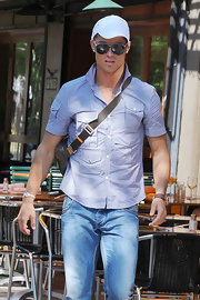 Cristiano paired his blue plaid shirt with a white baseball cap.